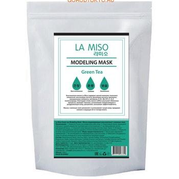 LA MISO Маска моделирующая (альгинатная) с зелёным чаем, 1 кг.КОРЕЙСКАЯ КОСМЕТИКА<br>Альгинатные маски La Miso содержат целый комплекс полезных элементов: альгиновую кислоту, фолиевую кислоту, протеины, минеральные элементы, витамины A, B1, B6, B12, C, D, E полисахариды.  Благодаря этому маски La Miso улучшают обменные процессы, выводят токсины, успокаивают покрасневшую и раздраженную кожу, увлажняют, оказывают эффект лифтинга. Маска с зеленым чаем увлажняет и успокаивает сухую кожу, придавая сияние и защищая её от потери влаги.  Применение: <br><br>Нанесите тоник на очищенную кожу лица.<br>Подготовьте маску: размешайте порошок с водой комнатной температуры в соотношении 1:1 до образования густой однородной массы.<br>Нанесите получившуюся маску на кожу лица.<br>Через 15-20 минут снимите затвердевшую маску и удалите остатки тоником или влажным спонжем.<br>Нанесите на кожу лица увлажняющий крем.<br><br>Состав: Diatomaceous Earth, Glucose, Algin, Calcium Sulfate, Tetrasodium Pyrophosphate, Magnesium Oxide, Sodium Benzoate, Camellia Sinensis Leaf Extract, Camellia Sinensis Leaf Powder(0.5%), Sodium Hyaluronate, Allantoin, Glycyrrhiza Glabra Root Extract, CI77288, Fragrance.<br>